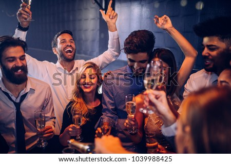 Group of friend having fun at the nightclub #1039988425