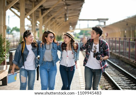 Group of friend traveler on the train station, Travel lifestyle and seasonal vacation concept.