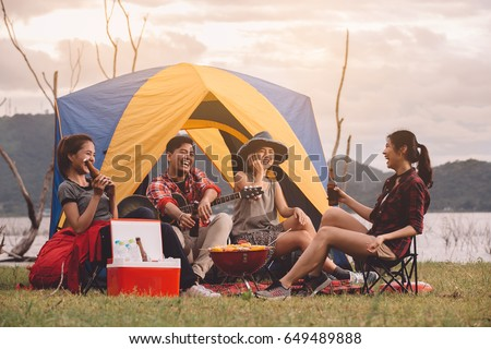 Group of Friends Asian Camp Forest Adventure Travel Remote Relax Concept, mountain view. Dinner party, Camping barbecue and drink beer. Stock photo ©