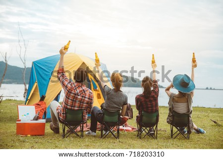 Group of Friends Asian having fun together and drinking beer Camp Forest Adventure Travel Remote Relax Concept,mountain view.
