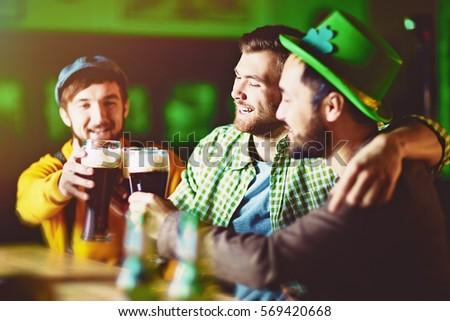 Group of Friends Celebrating at Irish Pub