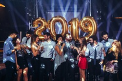 Group of friends celebrating New Year with champagne