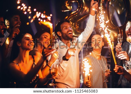 Group of friends celebrating with champagne