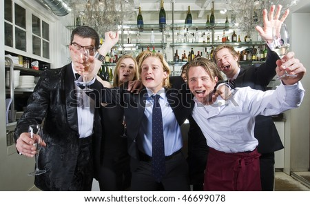 Group of friends cheering in a restaurant bar