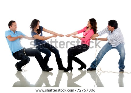 Group of friends competing pulling a rope - isolated over a white background