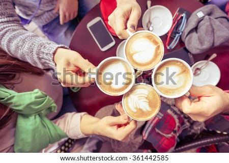 Group of friends drinking cappuccino at coffee bar restaurant - People hands cheering and toasting with upper view point - Social gathering concept with men and women - Vintage marsala filtered look #361442585