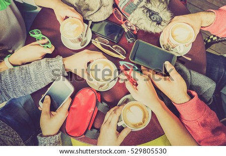 Group of friends drinking cappuccino at coffee bar restaurant - People hands using smartphone on upper point of view - Technology concept with addicted men and women - Desaturated lomo vintage filter