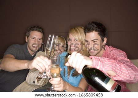 Photo of Group of friends drinking champagne