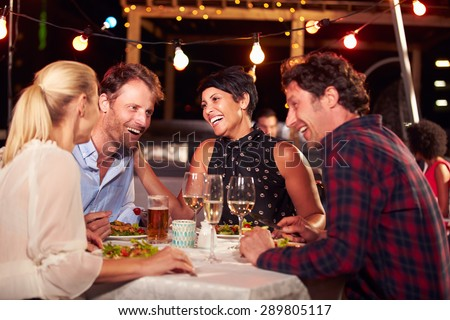 Group of friends eating dinner at rooftop restaurant #289805117
