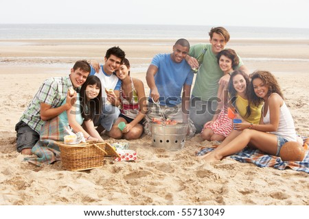 Group Of Friends Enjoying Barbeque On Beach Together