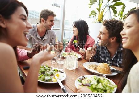 Shutterstock Group Of Friends Enjoying Meal At Rooftop Restaurant