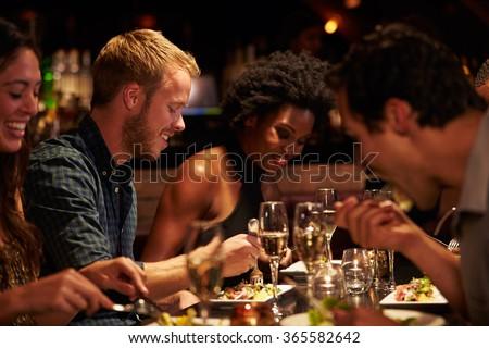 Shutterstock Group Of Friends Enjoying Meal In Restaurant
