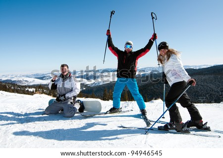 Group of friends enjoying skiing and snowboarding at a ski resort