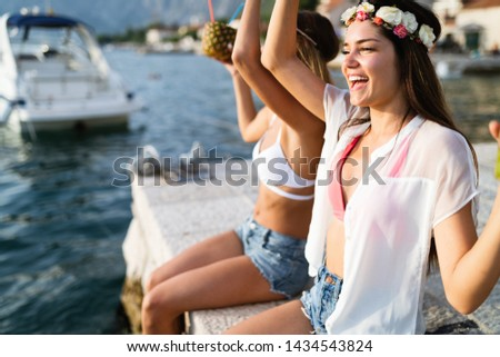 Group of friends enjoying summer vacation. Summer, holidays, vacation and happiness concept #1434543824