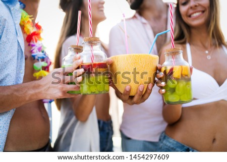 Group of friends enjoying summer vacation. Summer, holidays, vacation and happiness concept #1454297609
