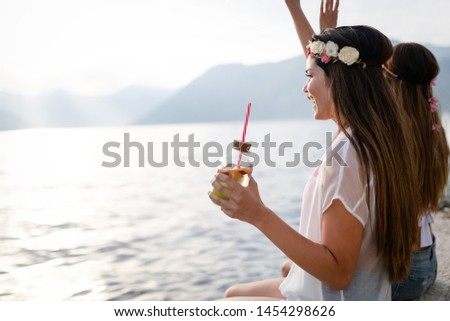 Group of friends enjoying summer vacation. Summer, holidays, vacation and happiness concept #1454298626