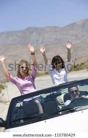 Group of friends enjoying their journey in car