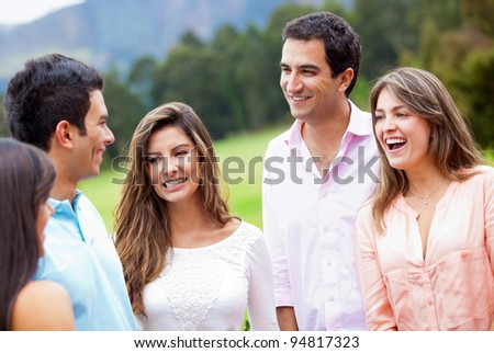 Group of friends hanging around outdoors and smiling