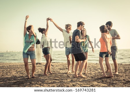 Group of Friends Having a Party on the Beach #169743281