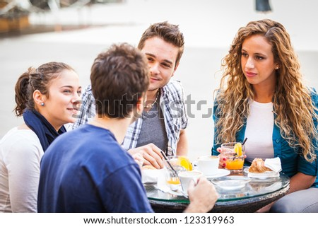 Group of Friends Having a Traditional Italian Breakfast