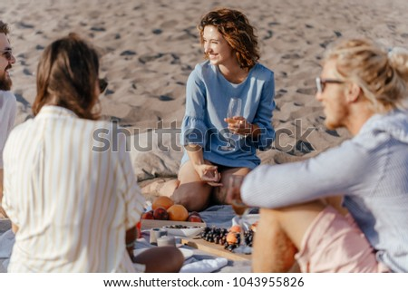 Group of friends having beac party on summer day.