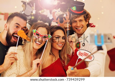 Group of friends having fun during Christmas
