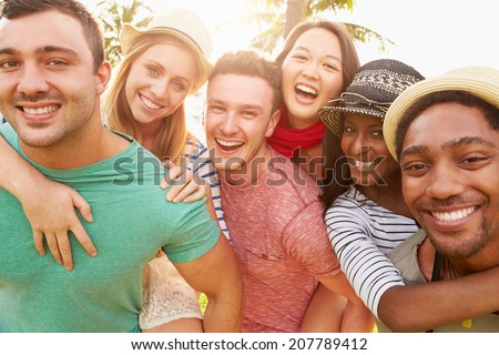 Group Of Friends Having Fun In Park Together #207789412