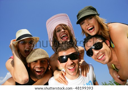 Group of friends having fun in summer vacation