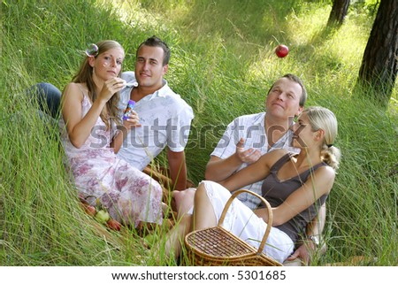 Group of friends having fun in the park