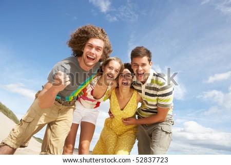 Group Of Friends Having Fun On Summer Beach - stock photo