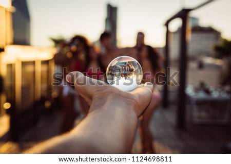 Group of friends having fun on the rooftop of a beautiful penthouse #1124698811