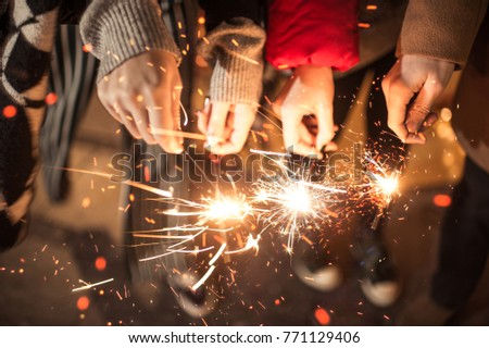 Group of friends having fun with sparklers #771129406