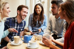 Group Of Friends In Caf�¢?? Using Digital Devices
