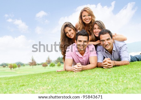 Group of friends lying outdoors having fun