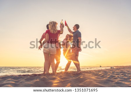 Group of friends make party on the beach #1351071695