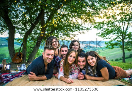 Group of friends making barbecue in the nature - Happy people having fun on a pic-nic in the countryside