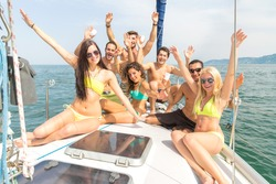 Group of friends on a boat having fun