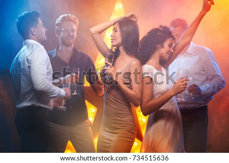 Group of friends party together indoors celebration #734515636