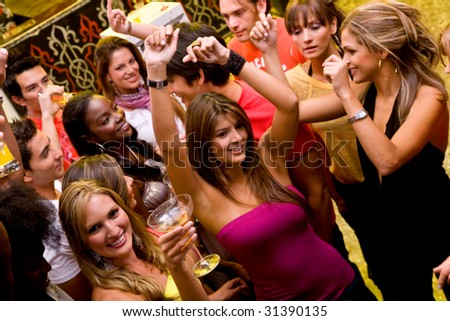 Group of friends partying at a disco - stock photo