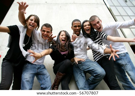 Group of friends screaming with arms up