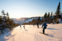 Group of friends skiing in the Chic Chocs in Quebec Canada