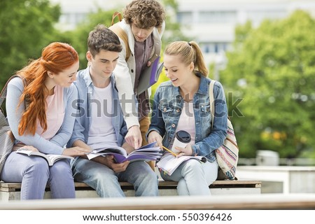 Group of friends studying together at university campus #550396426