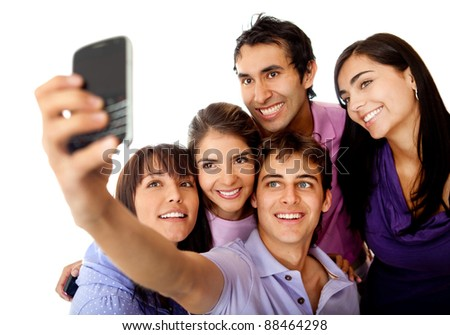Group of friends taking a photo with their phone