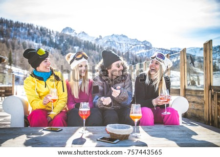 Group of friends talking and having fun in a outdoor restaurant on winter holidays #757443565