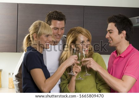 Photo of Group of friends toasting with champagne