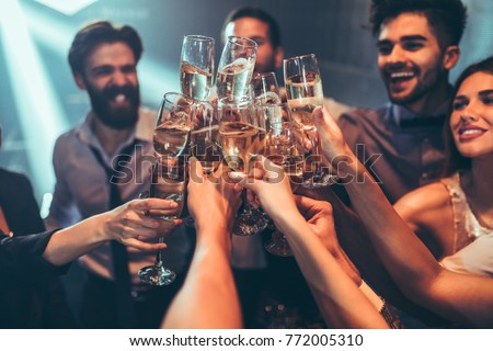 Group of friends toasting with champagne