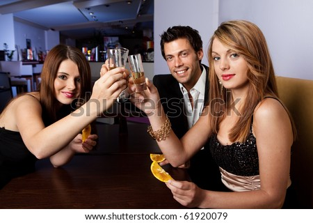 Group of friends together having fun. Focus on glasses - stock photo