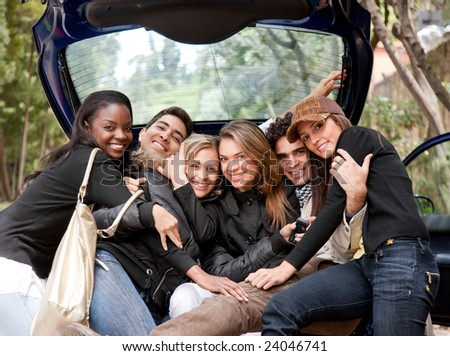 Group of friends together in the back of a car