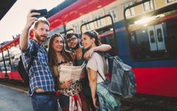 Group of friends traveling by train