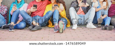 Group of friends using smart mobile phones - Teenagers addiction to new technology trends -